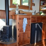 Small stove in colins coastal cabin project