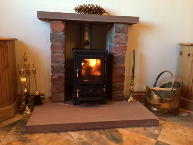Small fireplaces salamander stoves for Small den with fireplace