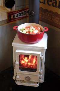small multi fuel stove used for cooking and heating a small garden room home office
