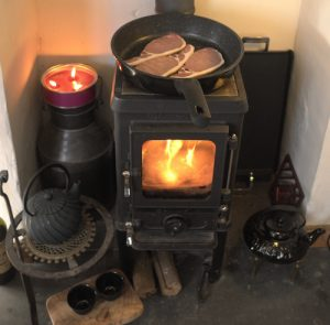 cooking on a small wood cookstove