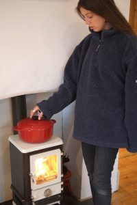 cooking on a tiny woodstove