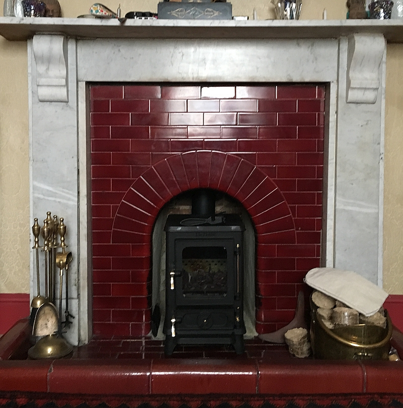 Tiny Stove in a Victorian Fireplace