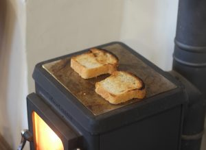 tiny wood stove turning bread into toast