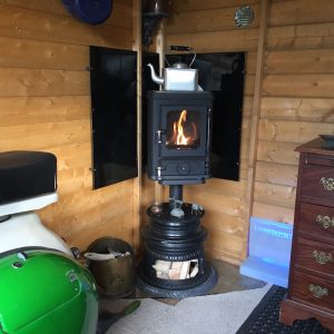 small stove installed in a shed