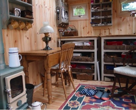 installing a woodstove into a garden office, wooden cabin
