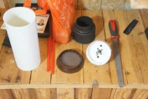the tools needed to install the flexible hose and pipe through the cavity wall.