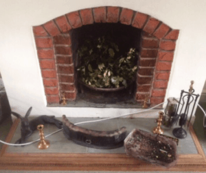 small fireplace before a stove