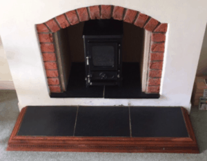 small fireplace with a stove