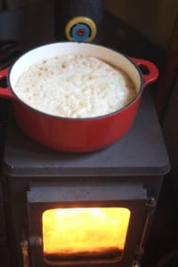 wood cookstove making steak and ale pie