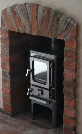 small multi fuel stove with steam punk industrial finish