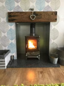 small stove in a small fireplace