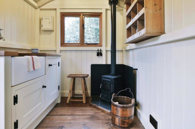 small stove in a shepherd's hut red sky