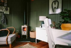 small log burner installed in a shed